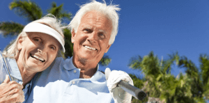 older golfing couple